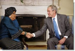 """President George W. Bush shakes hands with Liberia President Ellen Johnson Sirleaf following their meeting Wednesday, Oct. 22, 2008, in the Oval Office at the White House. President Bush said to President Sirleaf, """"I have come to respect you and admire you because of your courage, your vision, your commitment to universal values and principles."""" White House photo by Eric Draper"""
