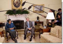 """President George W. Bush and Liberia President Ellen Johnson Sirleaf talk with reporters following their meeting Wednesday, Oct. 22, 2008, in the Oval Office at the White House. President Bush said during his remarks, """"Liberia needs the help of the United States and other nations to help make sure children are educated, to make sure babies are not dying because of malaria, to make sure there's an infrastructure so that small businesses can flourish, to make sure port is open for business. We have been helpful and we want to be helpful in the future."""" White House photo by Eric Draper"""