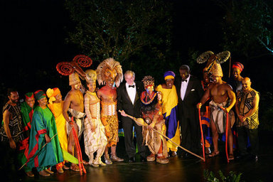 President George W. Bush and President John Agyekum Kufuor of Ghana join cast members of the Lion King on stage in the Rose Garden at the White House Monday evening, Sept. 15, 2008, following their performance at the State Dinner in honor of President Kufour's visit to the United States. White House photo by Chris Greenberg
