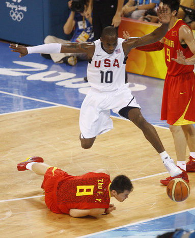 U.S. Olympic Men's Basketball team member Kobe Bryant leaps over a member of China's team chasing for a loose ball Sunday, Aug. 10, 2008, during action in the Group B men's Olympic basketball game between the U.S. and China, at the 2008 Summer Olympic Games in Beijing. White House photo by Eric Draper