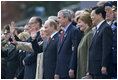 President George W. Bush and Laura Bush stand with Russian President Vladimir Putin and Ludmila Putina, French President Jacque Chirac, far left, and Chinese President Hu Jintao, right, as many heads of state watch a parade in Moscow's Red Square commemorating the end of World War II Monday, May 9, 2005.