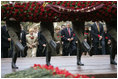 Commemorating the 60th Anniversary of the end of World War II, President George W. Bush and Laura Bush join world leaders in a wreath laying ceremony at the Tomb of the Unknown Soldier at the Kremlin wall Monday, May 9, 2005.