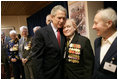 During a meeting with U.S. and Russian veterans, President George W. Bush hugs Russian veteran Vasik Ivanovich Korneer after he offered the President a coin from his service in Berlin during World War II in Moscow, Monday, May 9, 2005. President Bush asked that the veteran give the coin to a family member and thanked him for his courage.