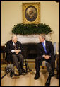 """President George W. Bush welcomes Cpl. Frank Woodruff Buckles, the last known surviving American-born WWI veteran, to the Oval Office Thursday, March 6, 2008. The President told the 107-year-old, """".One way for me to honor the service of those who wear the uniform in the past and those who wear it today is to herald you, sir, and to thank you very much for your patriotism and your love for America."""" White House photo by Eric Draper"""