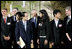 President George W. Bush and Japanese Prime Minister Yasuo Fukuda speak with United States J-8 representative Manogna Manne of Pleasanton, Calif., a member of the J-8 young leaders from the Group of Eight countries, attending the 2008 G-8 Summit in Toyako, Japan.