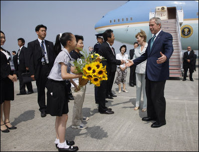 President George W. Bush and Laura Bush are welcomed on their arrival Sunday, July 6, 2008 to the New Chitose International Airport, to attend the Group of Eight Summit in Toyako, Japan.