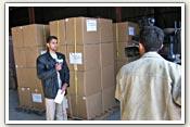 An Iraqi journalists files a news report