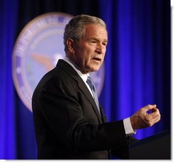 """President George W. Bush delivers remarks on the Global War on Terror during a visit Wednesday, March 19, 2008, to the Pentagon. In addressing representatives from each branch of the military -- including some who served in the theater at the beginning of Operation Iraqi Freedom, the President said, """"Five years into this battle, there is an understandable debate over whether the war was worth fighting, whether the fight is worth winning, and whether we can win it. The answers are clear to me: Removing Saddam Hussein from power was the right decision -- and this is a fight America can and must win."""" White House photo by Eric Draper"""
