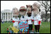 The Presidential character mascots of the Washington Nationals baseball team, Thomas Jefferson, Teddy Roosevelt, Abraham Lincoln and George Washington participate Monday, March 24, 2008 on the South Lawn of the White House, at the 2008 White House Easter Egg Roll.
