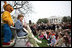 "Mrs. Laura Bush, joined by her daughter, Jenna, and the PBS character ""Arthur,"" reads the book ""Arthur Meets the President,"" Monday, March 24, 2008, during festivities at the 2008 White House Easter Egg Roll on the South Lawn of the White House."