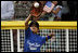 The first baseman of the Jose M. Rodriguez Little League Angels from Manatí, Puerto Rico reaches up to catch the ball during the season opener of the 2008 Tee Ball on the South Lawn Monday, June 30, 2008, on the South Lawn of the White House.