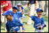 Players of the Jose M. Rodriguez Little League Angels of Manatí, Puerto Rico, jubilate at the conclusion the 2008 Tee Ball on the South Lawn Season Opener Monday, June 30, 2008, on the South Lawn of the White House.