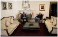 President George W. Bush and Afghan President Hamid Karzai talk Wednesday, March 1, 2006, in the Presidential Palace in Kabul. President and Mrs. Bush made the surprise five-hour stop in Afghanistan en route to India.