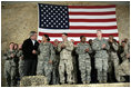 President George W. Bush meets and thanks a group of U.S. and Coalition troops, Wednesday, March 1, 2006, during a visit to Bagram Air Base in Afghanistan, where President Bush thanked the troops for their service in defense of freedom.