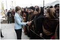 Mrs. Laura Bush greets a welcoming delegation of women, Wednesday, March 1, 2006, at the dedication of the new U.S. Embassy Building in Kabul, Afghanistan.