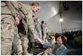 Mrs. Laura Bush greets U.S. and Coalition troops Wednesday, March 1, 2006, during a stopover at Bagram Air Base in Afghanistan, prior to the President and Mrs. Bush visiting India and Pakistan.