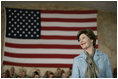 Mrs.Laura Bush appears before an audience of U.S. and Coalition troops, Wednesday, March 1, 2006, during a visit to Bagram Air Base in Afghanistan, where President George W. Bush thanked the troops for their service in defense of freedom.