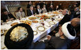 President George W. Bush and President Hamid Karzai of Afghanistan share a working lunch Wednesday, March 1, 2006, at the Presidential Palace in Kabul during a stop by President Bush en route to India.