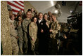 President George W. Bush poses for photos with U.S. and Coalition troops Wednesday, March 1, 2006, during a stopover at Bagram Air Base in Afghanistan, prior to his visit to India and Pakistan.