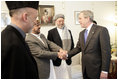 President George W. Bush meets members of President Hamid Karzai's government upon his arrival for a working lunch at the Presidential Palace in Kabul, Afghanistan Wednesday, March 1, 2006.