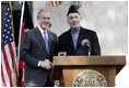 President George W. Bush and President Hamid Karzai of Afghanistan appear together Wednesday, March 1, 2006 at a joint news conference at the Presidential Palace in Kabul, Afganistan.