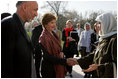 Afghan President Hamid Karzai introduces his wife, Dr. Karzai, to Laura Bush outside the presidential residence in Kabul, Afghanistan, Wednesday, March 30, 2005.