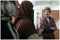 Laura Bush talks with female students in the newly built National Women's Dormitory on the campus of Kabul University Wednesday, March 30, 2005, in Kabul, Afghanistan. The women's dormitory was built to provide a safe place for young women to live while pursuing studies away from their families.