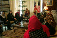 Laura Bush and Dr. Zenat Karzai, wife of President Hamid Karzai, U. S. Secretary of Education Margaret Spellings, second left, and Under Secretary of State for Global Affairs Paul Dobrianski, left, talk with Afghan women about issues of women's rights and education at the presidential residence in Kabul, Afghanistan Wednesday, March 30, 2005.