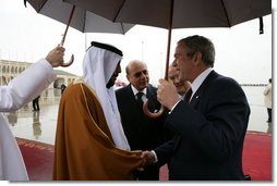 President George W. Bush is greeted by President Sheikh Khalifa bin Zayed Al Nayhan after arriving Sunday, Jan. 13, 2008, at Abu Dhabi International Airport in the United Arab Emirates. White House photo by Chris Greenberg