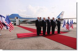 President George W. Bush is joined on the red carpet by Israel's Prime Minister Ehud Olmert, right, President Shimon Peres, second from left, and Ambassador Yitzhak Eldan, Israel's Chief of Protocol, after arriving Wednesday, Jan. 9, 2008, in Tel Aviv for the first stop of his Mideast visit.  White House photo by Eric Draper