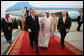 President George W. Bush and King Abdullah bin Abdul Al-Aziz walk the red carpet at Riyadh-King Khaled International Airport after the President arrived Monday, Jan. 14, 2008, in Riyadh, Saudi Arabia on the final stop of his Mideast visit. White House photo by Eric Draper