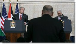 President George W. Bush and President Mahmoud Abbas of the Palestinian Authority, listen to a reporter's question Thursday, Jan. 10, 2008, during a joint press availability at in Ramallah. White House photo by Chris Greenberg