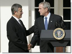 President George W. Bush shakes the hand of Mike Johanns, resigning Secretary of Agriculture, after he announced the secretary's decision to return to his home state of Nebraska during a morning statement in the Rose Garden. White House photo by Joyce N. Boghosian