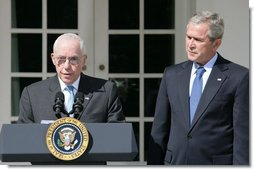 """President George W. Bush listens to remarks by Judge Michael Mukasey after announcing his nomination Monday, Sept. 17, 2007, in the Rose Garden, to be the 81st Attorney General of the United States. In thanking the President, Judge Mukasey said, """"The department faces challenges vastly different from those it faced when I was an assistant U.S. attorney 35 years ago. But the principles that guide the department remain the same -- to pursue justice by enforcing the law with unswerving fidelity to the Constitution.""""  White House photo by Chris Greenberg"""