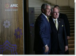 President George W. Bush is welcomed to the APEC Business Summit by Australia's Prime Minister John Howard Friday, Sept. 7, 2007, at the Sydney Opera House. White House photo by Eric Draper