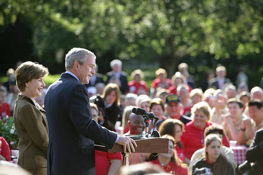 """Standing with Mrs. Laura Bush, President George W. Bush addresses military support organizations Tuesday, Sept. 18, 2007, on the South Lawn. """"Laura and I welcome the families who have got a loved one overseas, whether it be in Iraq or Afghanistan, fighting these extremists and terrorists,"""" said President Bush. """"The best way to honor your loved one is to make sure that he or she has the full support of the United States government as you accomplish the mission that we have set."""" White House photo by David Bohrer"""