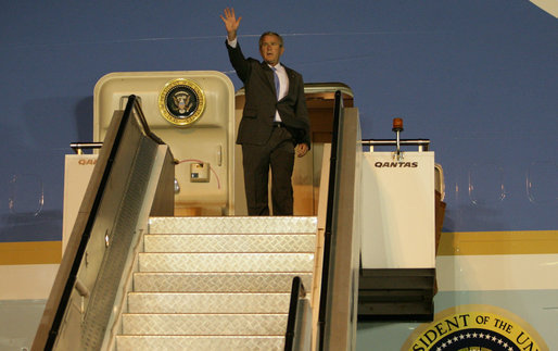 President George W. Bush waves from Air Force One after landing in Sydney Tuesday, Sept. 4, 2007, to attend the Asian-Pacific Economic Cooperation. White House photo by Eric Draper