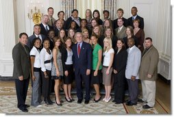 President George W. Bush stands with members of Arizona State University Women's Indoor & Outdoor Track and Field Championship Team Friday, Sept. 21, 2007, at the White House during a photo opportunity with the 2006 and 2007 NCAA Sports Champions. White House photo by Chris Greenberg