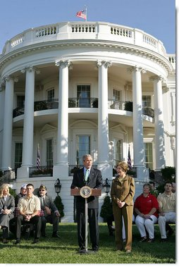 """Standing with Mrs. Laura Bush, President George W. Bush addresses military support organizations Tuesday, Sept. 18, 2007, on the South Lawn. """"I feel a very strong obligation, since it was my decision that committed young men and women into combat, to make sure our veterans who are coming back from Iraq and Afghanistan get all the help this government can possibly provide,"""" said President Bush. White House photo by Chris Greenberg"""