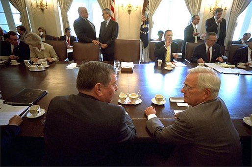 Shortly before the President arrives for his Cabinet meeting, Attorney General John Ashcroft and Secretary of Treasury Paul O'Neill talk in the Cabinet Room at the White House Wednesday, July 31. White House photo by Eric Draper.