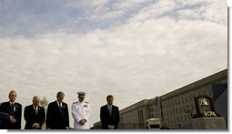 President George W. Bush is joined from left by former Secretary of Defense Donald Rumsfeld, U.S. Secretary of Defense Robert Gates, Chairman of the Joint Chiefs of Staff, Admiral Michael Mullen and James J. Laychak, chairman of the Pentagon Memorial Fund, Inc. as they bow their heads during a Moment of Silence Thursday, Sept. 11, 2008, at the dedication of the 9/11 Pentagon Memorial at the Pentagon in Arlington, Va.  White House photo by Eric Draper