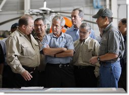 """President George W. Bush meets with locals officials at the U.S. Coast Guard facility at Ellington Field in Houston Tuesday, Sept. 16, 2008 before taking an aerial tour of Texas areas damaged in last weekend's hurricane. Said the President afterward, """"My first observation is that the state government and local folks are working very closely and working hard and have put a good response together. The evacuation plan was excellent in its planning and in execution. The rescue plan was very bold, and we owe a debt of gratitude to those who were on the front line pulling people out of harm's way, like the Coast Guard people behind us here.""""  White House photo by Eric Draper"""