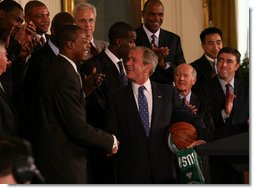 President George W. Bush shakes hands with Paul Pierce, team captain of the Boston Celtics, after Pierce presented him with a signed basketball and jersey Friday, Sept. 19, 2008, on behalf of the 2008 NBA Championship team. Pierce used the occasion of the team's visit to the White House to announce its donation of $100,000 to the American Red Cross to aid those affected by Hurricane Ike. White House photo by Joyce N. Boghosian