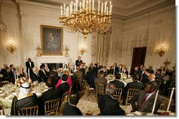 President George W. Bush welcomes guests to the Iftaar Dinner with Ambassadors and Muslim leaders in the State Dining Room of the White House, Thursday, Sept. 17, 2008, to celebrate the traditions of Islamic faith and culture. White House photo by Chris Greenberg