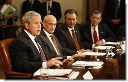 With Secretary Michael Chertoff of the Department of Homeland Security beside him, President George W. Bush speaks to the media in the Roosevelt Room Monday, Sept. 15, 2008, during an update on Hurricane Ike response and relief efforts. White House photo by Eric Draper