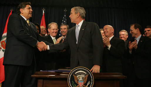 """President George W. Bush shakes the hand of Peru's President Alan Garcia after signing H.R. 3688, the United States-Peru Trade Promotion Agreement Implementation Act, Friday, Dec. 14, 2007, in the Dwight D. Eisenhower Executive Office Building. In signing the agreement, the President said, """"Peru and the United States are strong partners and today we're making that partnership even stronger."""" White House photo by Joyce N. Boghosian"""