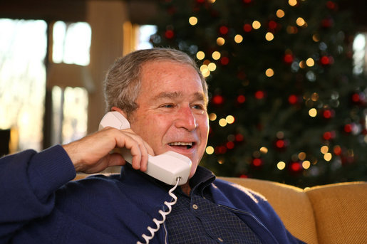 President George W. Bush makes Christmas Eve telephone calls to members of the Armed Forces at Camp David, Monday, Dec. 24, 2007. White House photo by Eric Draper