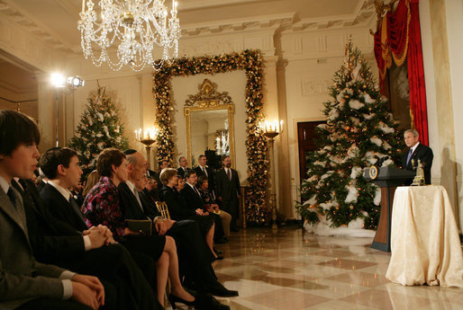 """President George W. Bush delivers remarks during the Menorah lighting Monday, Dec. 10, 2007, in the Grand Foyer of the White House. Said the President, """"Laura and I wish people of Jewish faith around the world a happy Hanukkah. May God bless you all."""" White House photo by Chris Greenberg"""