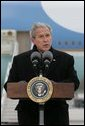 "President George W. Bush delivers a statement on Iran Wednesday, Dec. 5, 2007, upon arrival at Eppley Airfield in Omaha. Said the President, ""It is clear. that the Iranian government has more to explain about its nuclear intentions and past actions."" White House photo by Chris Greenberg"