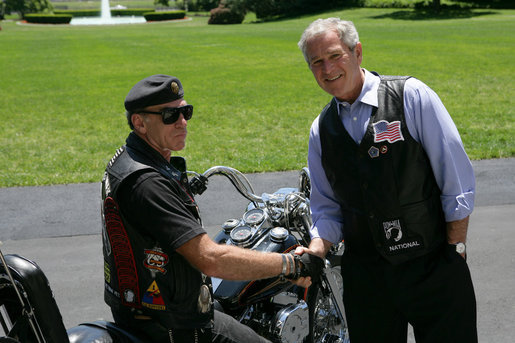 President George W. Bush poses for a photo with National Executive Director of Rolling Thunder Artie Muller at the conclusion of a visit by the motorcycle group to the White House. White House photo by Chris Greenberg